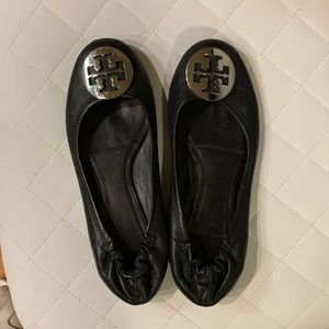 Tory Burch black leather flats with silver logo